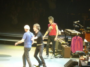 Mick Jagger cajoles Charlie Watts into taking a bow at the 50 and Counting tour stop in Toronto on May 25 2013