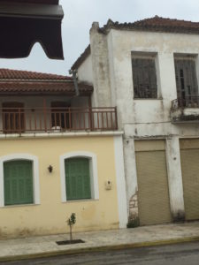 Typical houses in Dorio, Messinia - old and dilapidated or new and yellow.