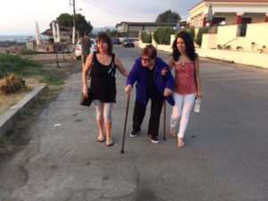 Yia Yia has difficulty walking even with two canes at Kalo Nero Beach.