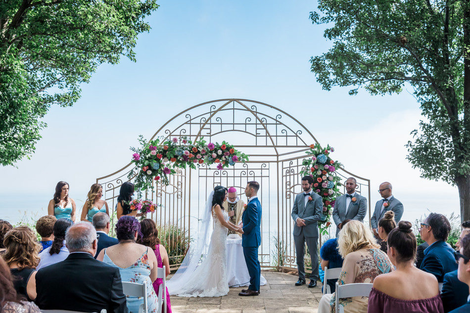 Bride and groom get married in front of floral arch at Toronto Hunt Club