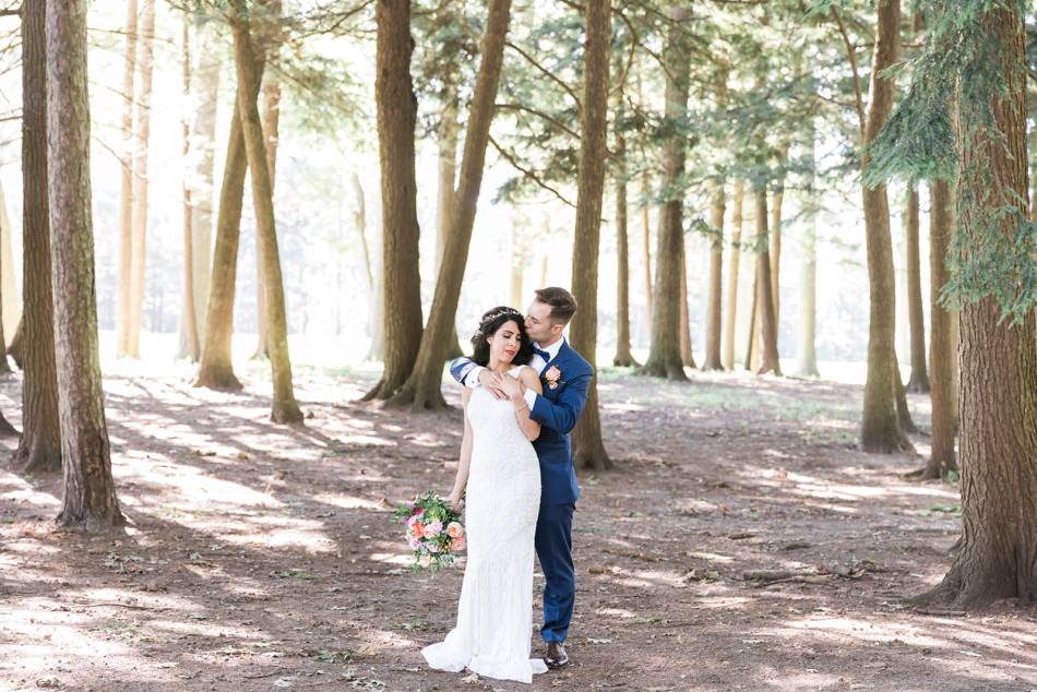 Bride and Groom among the trees at Toronto Hunt Club
