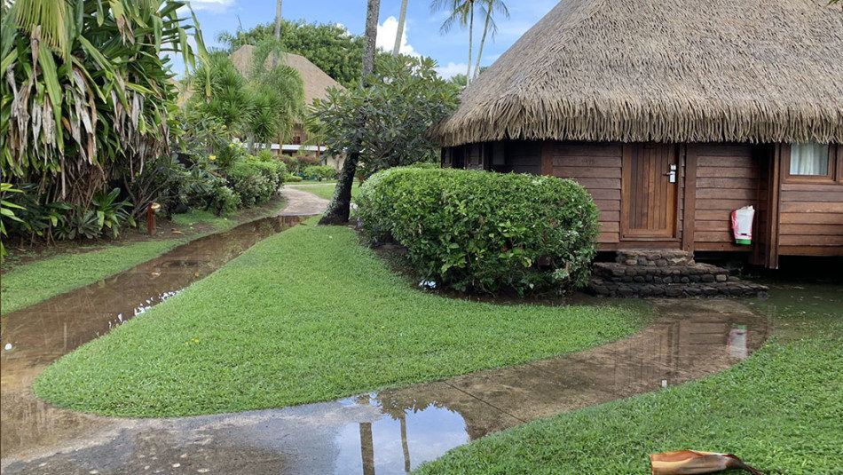 Waterclogged pathways at Manava Resort in Moorea after storm during shoulder season in April